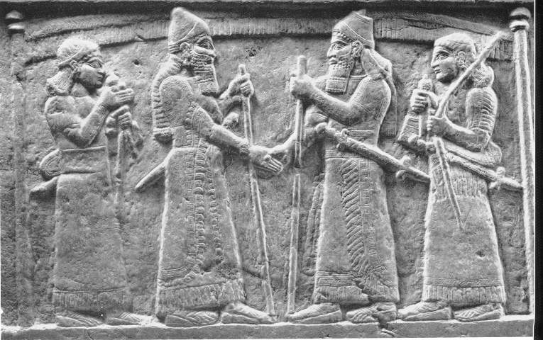 Carving depicting an Assyrian king and Marduk-zakir-sumi I, king of Babylon from 855-819 BC, shaking hands in a display of friendship